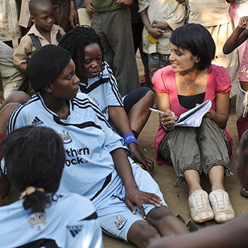 Sasha Kasthuriarachchi in discussion with a woman's football team supported by PEPAIDS. 2010. Photo Credit: ©Matthew Oldfield.