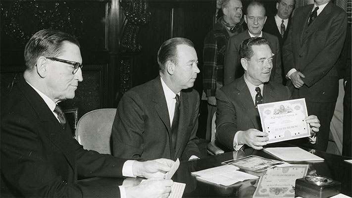 Foundation president H. Rowan Gaither with Ford Motor Company stock certificate. 1956. Photo Credit: © Ford Foundation